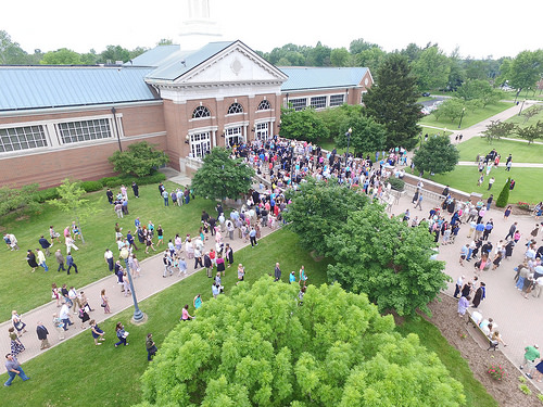 aerial view of campus building with crowd